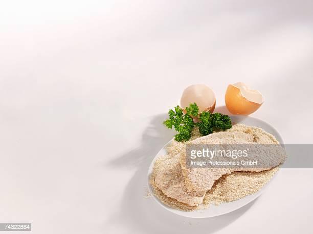 Raw, breaded Wiener Schnitzel (veal escalopes)