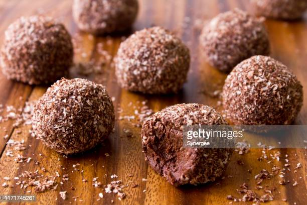 raw chocolate bliss balls - ball stock pictures, royalty-free photos & images