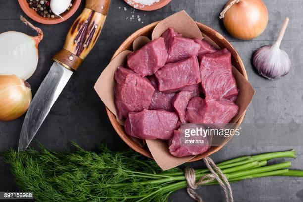 Raw chopped beef in ceramic bowl