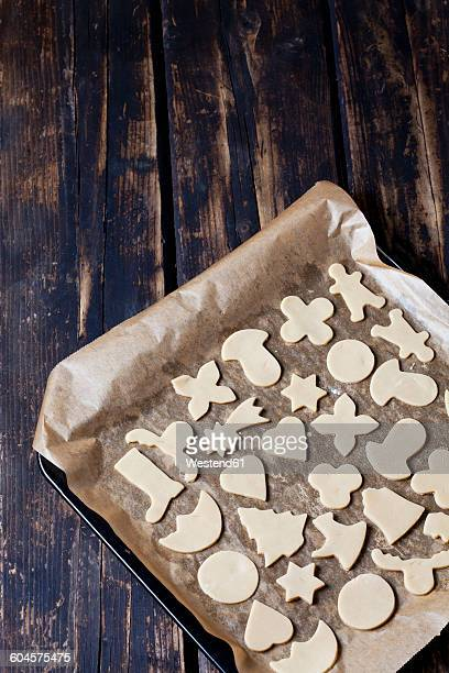 Raw Christmas cookies on baking tray