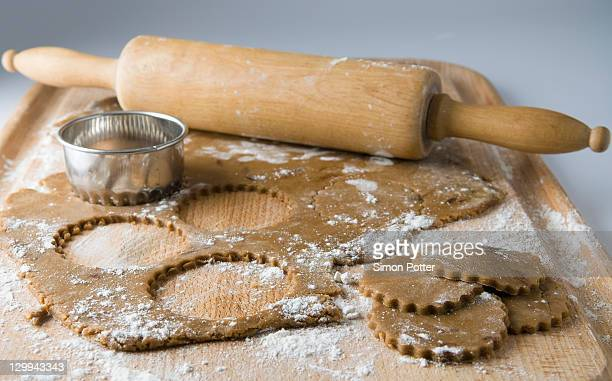 Raw cookies with dough and rolling pin