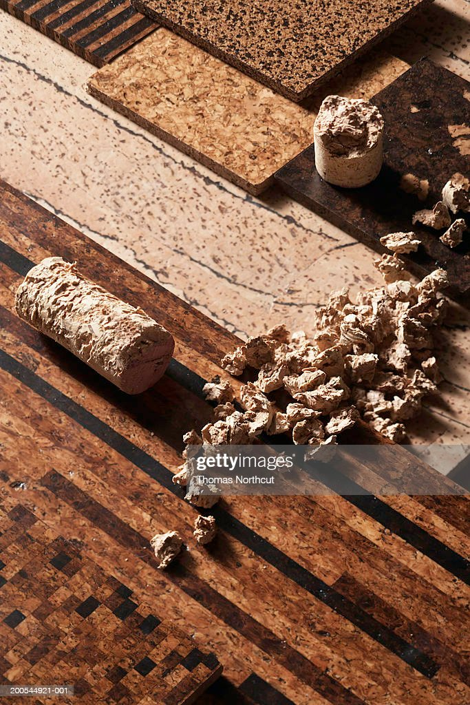 Raw Cork And Wine Corks Atop Orted Tiles Elevated View Stock Photo