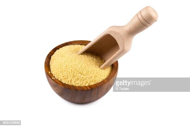 raw couscous in a wooden bowl on white background - bulgur bildbanksfoton och bilder
