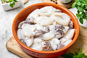 raw cuttlefish ceramic plate kitchen table
