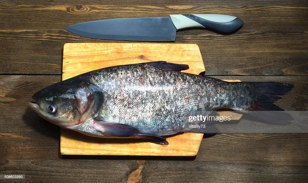 raw fish on wooden table as background : Stock Photo
