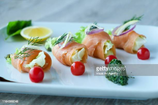 raw fish with lettuce - redfish stock photos and pictures