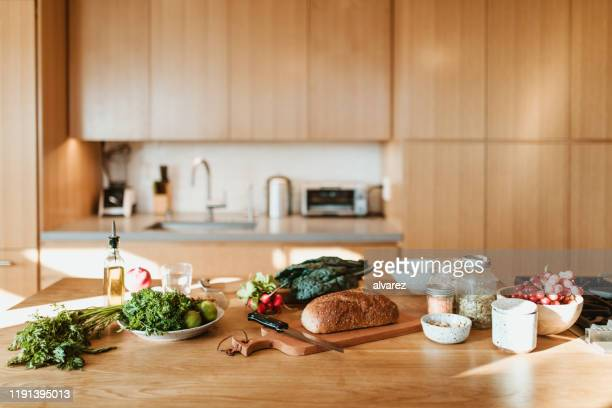 raw food and ingredients on kitchen island at home - ingredient stock pictures, royalty-free photos & images