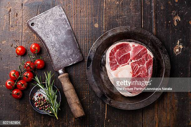 Raw fresh cross cut veal shank for making Osso Buco and meat cle