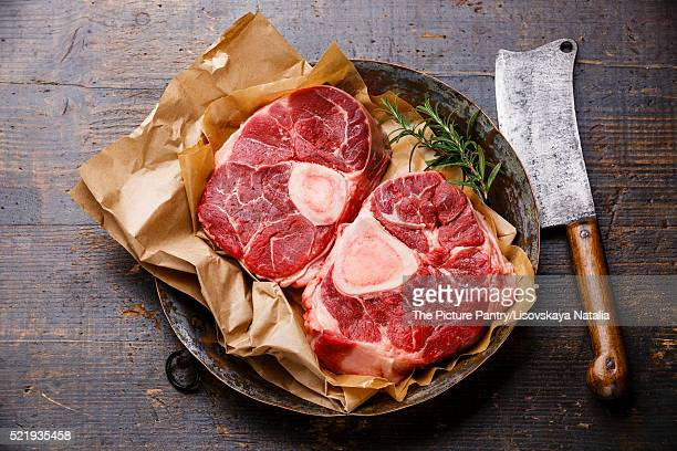 Raw fresh cross cut veal shank for making Osso Buco on metal cop