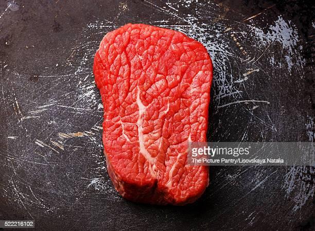 Raw fresh marbled meat Steak on dark metal background