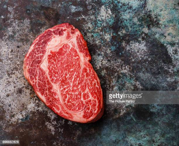 Raw fresh marbled meat Steak Ribeye Black Angus on metal background
