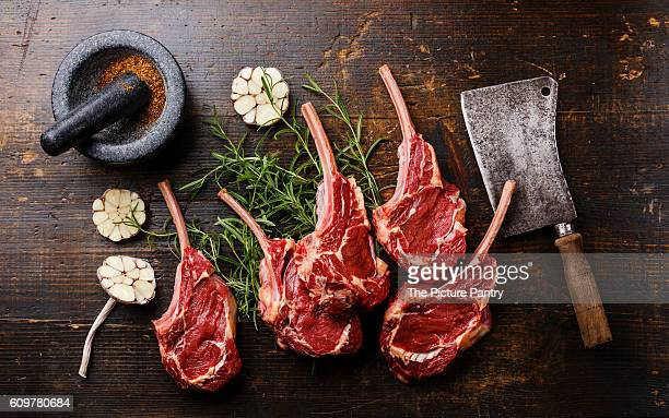 Raw fresh meat Veal ribs, spices and Meat cleaver on wooden background