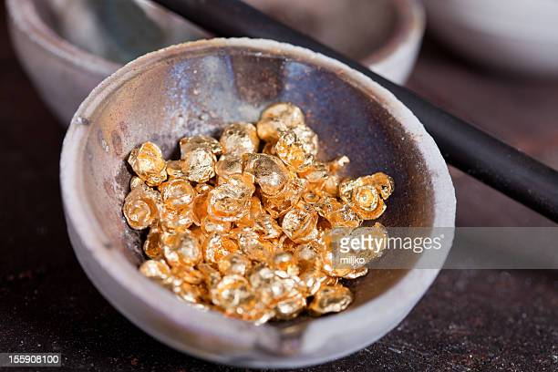 Raw gold in bowl straight from the mine