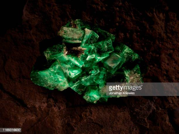 raw green emerald stone - emerald gemstone stock pictures, royalty-free photos & images