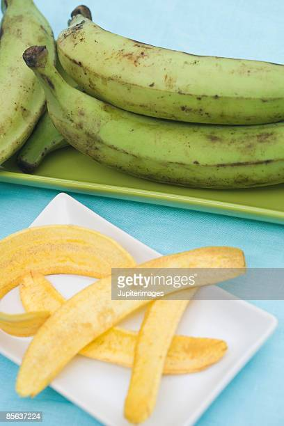 Raw green plantains and fried tostones