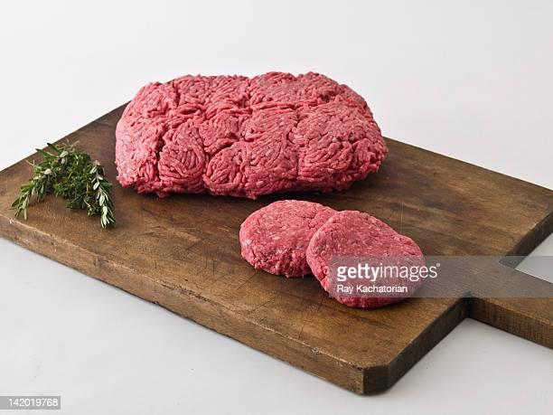 Raw hamburger meat on cutting board