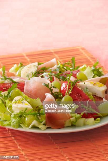 raw ham,goat's cheese and grape salad - vertebrate stock pictures, royalty-free photos & images