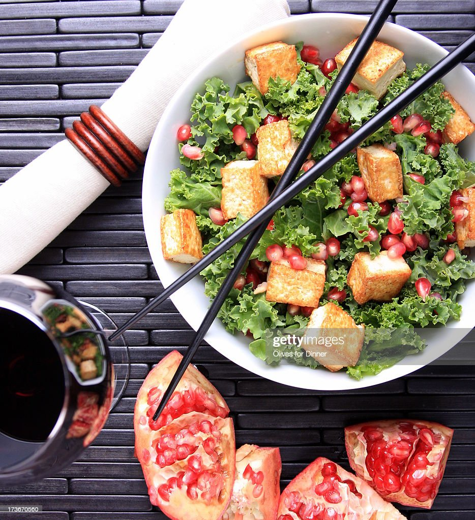 Raw Kale with Tofu Croutons and Pomegranate-Sesame : Stock Photo