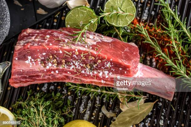 Raw Large Short Ribs with salt and spices top view