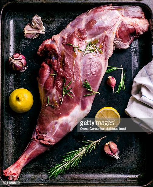 Raw leg of lamb with herb