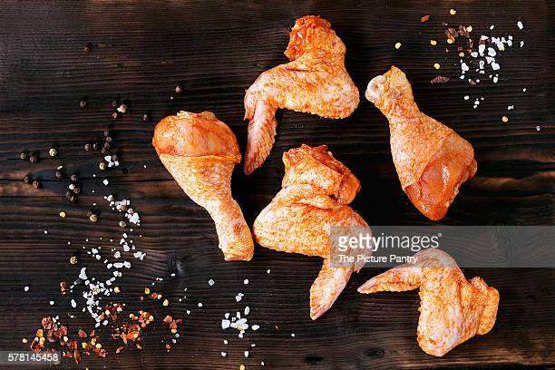 Raw Marinated chicken meat wings and legs