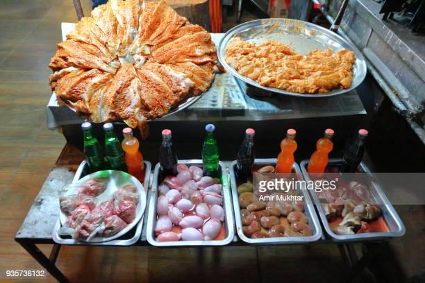 raw marinated fish along with lamb internal organs - heart internal organ stock pictures, royalty-free photos & images