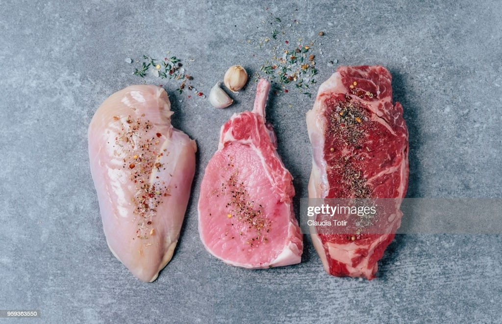 Raw meat (chicken breast, pork chop, and beef steak) : Stock Photo