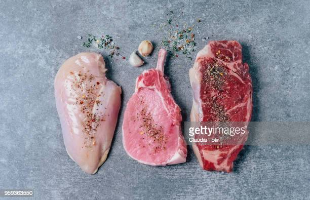 raw meat (chicken breast, pork chop, and beef steak) - red meat stock pictures, royalty-free photos & images