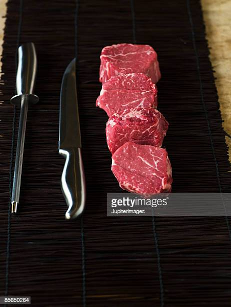 Raw meat with knife sharpener