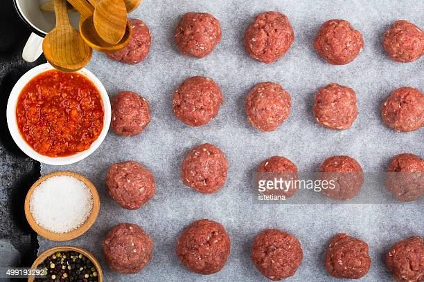 Raw meatballs and meatball ingredients, top view
