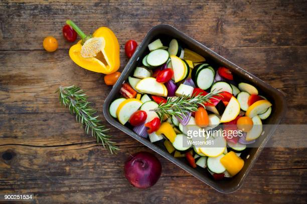 Raw Mediterranean oven vegetables on roasting tray