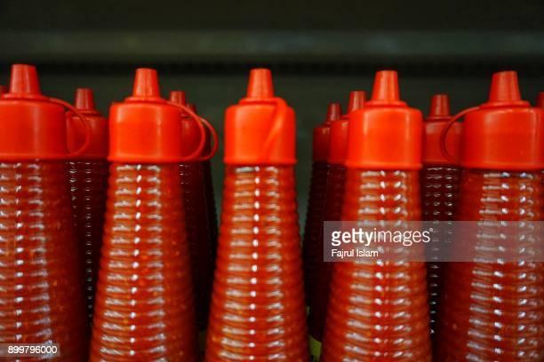 Raw of bottles of sauce
