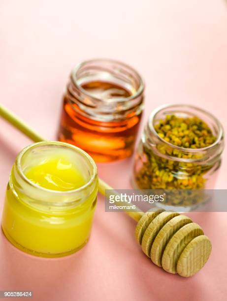 Raw organic bee pollen, royal jelly and honey in jar. Bee pollen granules. Apitherapy