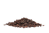 Raw organic cacao nibs isolated on white
