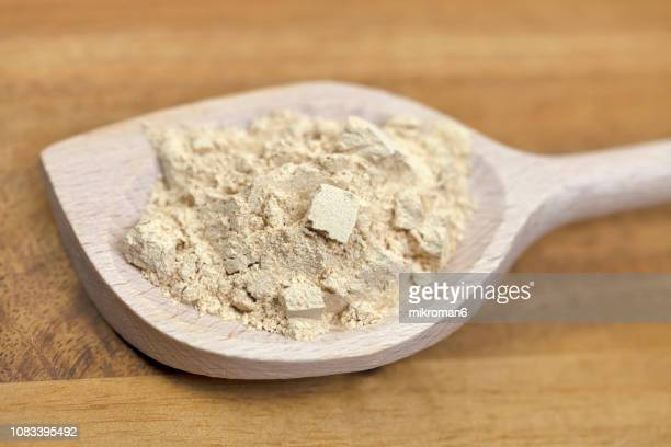 raw organic maca powder - maca plant stock photos and pictures