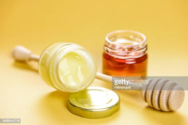 Raw organic royal jelly and honey in jar. Apitherapy