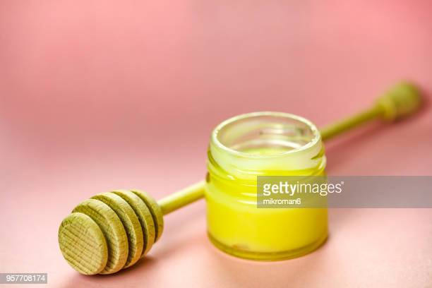 Raw organic royal jelly in a small jar. Apitherapy