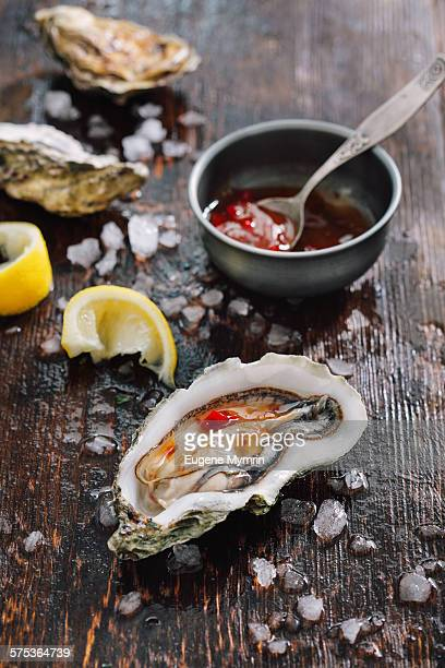Raw oysters with lemon and sauce