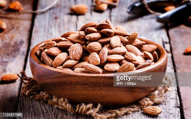 Raw Peeled Almond, Vintage Wooden Background, Selective Focus