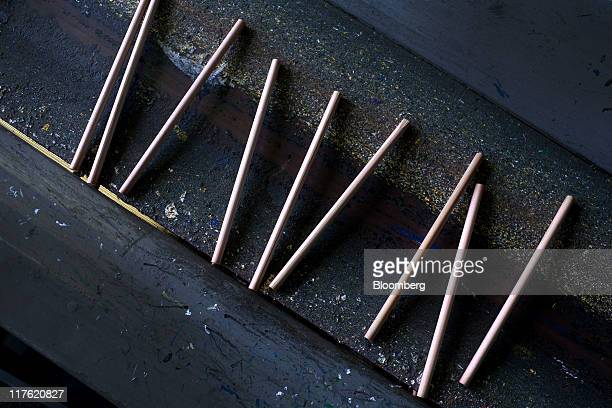 Raw pencils move along a conveyor belt at the General Pencil Co's factory in Jersey City New Jersey US on Wednesday June 22 2011 General Pencil Co...