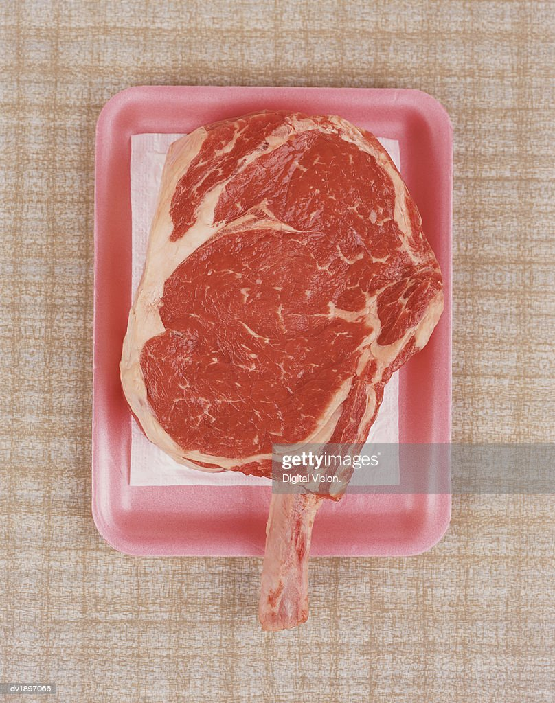Raw Piece of Meat on Pink Tray : Stock Photo