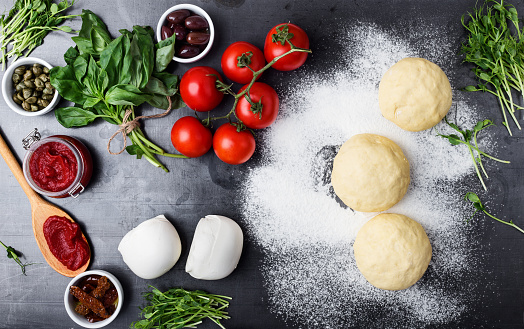 Raw pizza dough with ingredients - gettyimageskorea