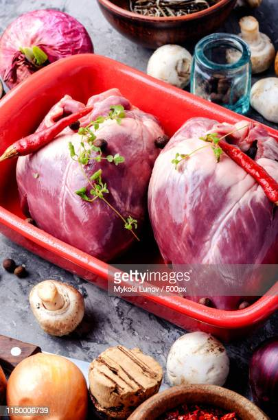 raw pork heart - animal internal organ stock photos and pictures