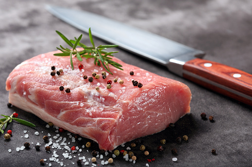 Raw pork loin with spices 886202174