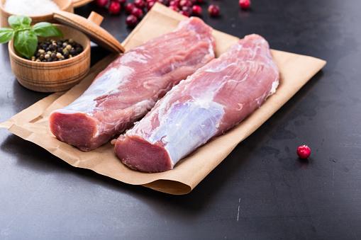 Raw pork tenderloin on craft pape 688595674