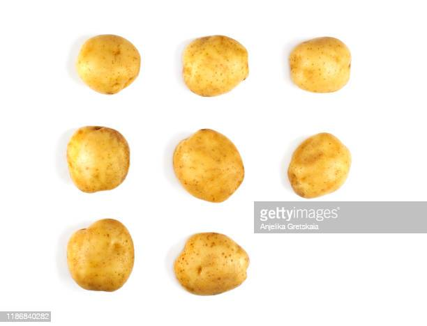 raw potatoes on white background. pattern with potatoes. vegetables abstract background - raw potato stock pictures, royalty-free photos & images