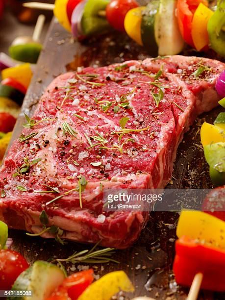 Raw Rib Eye Steak with Vegetable Kabobs