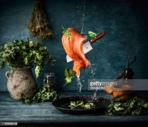 raw salmon fillet cooking preparation. flying food - servierfertig stock-fotos und bilder