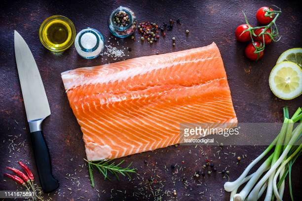 raw salmon fillet ready for cooking shot from above - fillet stock pictures, royalty-free photos & images