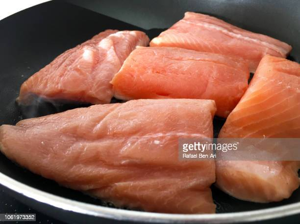 Raw Salmon Fish Fillets  on a Frying Pan